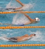 Neil Walker has a slight lead at the 65m mark in the heats of the 100 Back.