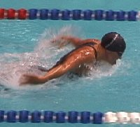 Jenny Thompson swimming fly.