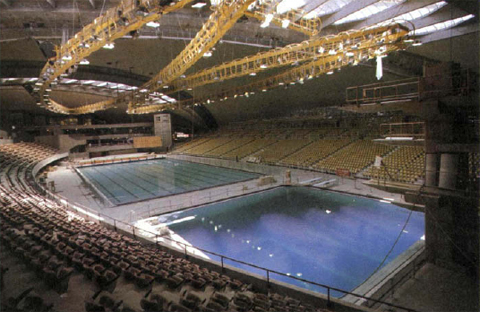 there for lights to further illuminate the facility for television cameras reportedly some shots of the swimming races were taken from those catwalks