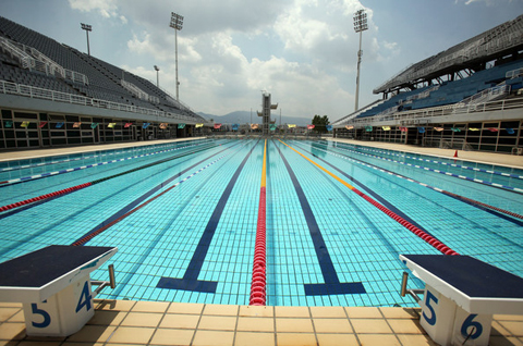 on a given week reports indicate that no more than 20 people visit the pool for swimming the greek swimming federation does not often hold competitions - Olympic Swimming Pool Top View