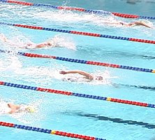 Tom Dolan (middle), Tom Wilkins (bottom), and Ron Karnaugh (top) are close together with 15m to go in the 200 IM.