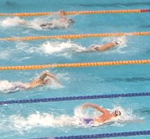 Rosolino (center) leads Dolan (top), and Wilkens (bottom) to the finish of the 200 IM.