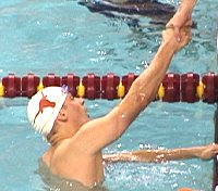 Texas anchor swimmer Bryan Jones is congratulated for the 400 Medley Relay victory