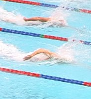 Neil Walker leads Matt Macedo in qualifying heats of the 50 Free.