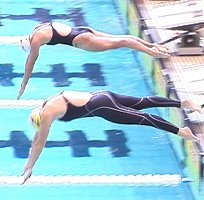 Brooke Bennett of Blue Wave, and Julie Varozza of Santa Clara, dive in for the 800 Free.