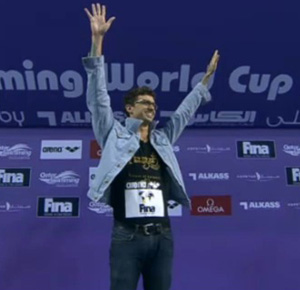 AE on podium in his jean jacket
