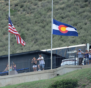 US and Colorado flags half mast