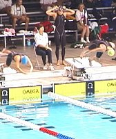 Haley Cope and Amy Van Dyken diving in for the 50 Free.