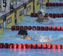 Katie Hoff touches the wall jsut ahead of Amanda Beard in the 200 IM final