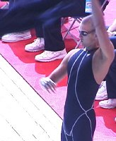 Anthony Ervin continues to stir up the crowd with a swing of his robe before the 100 Free Final.