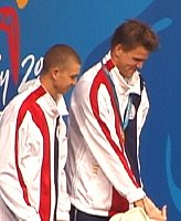 Gary Hall and Anthony Ervin share the gold medal stand in the 50 free.