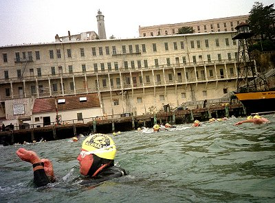 Photo by Peter Kapetanic  Start of the Sharfest swim with Alcatraz in the background.   Thank goodness for wetsuits.