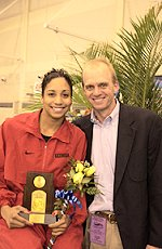 Auburn great Rowdy gaines presents award to Georgia's Maritza Correia, who set an American and NCAA record in the 100 free.