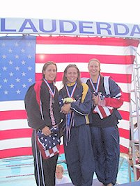 Natalie Coughlin accepts her award after breaking the American record in the 200m back (2:08.53).  On her left is Jamie Reid (second); on her right is Margaret Hoelzer (third). 2002 LCM Nationals<br />