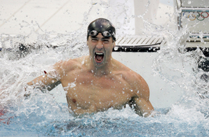 Michael Phelps celebrates winning the 100 fly and gold medal number seven at the Beijing Olympics