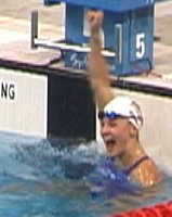 Megan Quann pumps her fist following her gold medal performance in the 100 Breast.