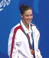 Megan Quann of the USA receives her gold medal for victory in the 100 Breast.