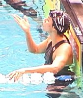 Ashley Tapin blows a kiss to friends after finishing third in the 100 Free final to make the Olympic team in the 4 x 100 Free Relay.