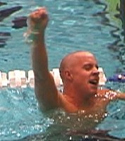 Erik Vendt, pumps his fist after breaking the American record in the 1500 and breaking the elusive 15 minute barrier with a 14:59.11.