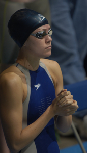 Natalie Coughlin qualifies first in 100 Free.