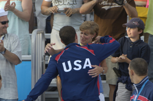 Brendan is congratulated by his mom after medals.