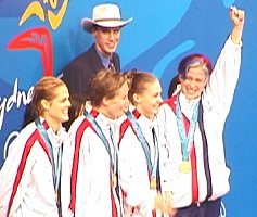 The USA women on the stand to accept gold for the 400 Medley Relay.