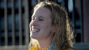 Marieke Guehrer (AUS) poses with the gold medal after winning the women's 50m butterfly in the 2010 Pan Pacific swimming championships at the William Woollett Jr. Aquatics Center.