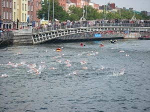Crowd gathers at Hapenny Bridge at Liffey Swim.