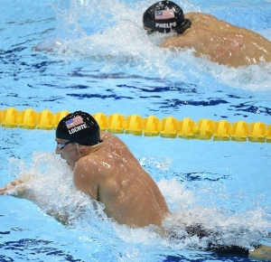 Americans Ryan Lochte (front) and teammate Michael Phelps swim the breast stroke portion of the 200m Individual Medley Semifinals during the London 2012 Olympic Games at Aquatics Centre.