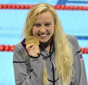Jessica Long (USA) shows off her medal after the medal ceremony for the women's 200 IM - SM8 during the London 2012 Paralympic Games at Aquatics Centre.