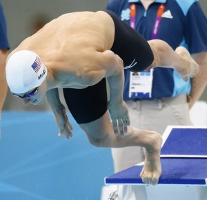 Tyler McGill (USA) dives in the men's 100m butterfly heat during the London 2012 Olympic Games at Aquatics Centre.