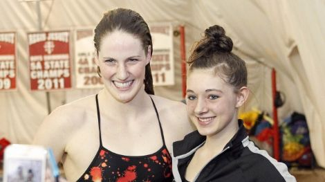 Fans take pictures with Regis Jesuit High School swimmer Missy Franklin after a meet against Highlands Ranch.