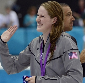 Missy Franklin (USA) waves to the crowd after winning a gold medal in the women's 100m backstroke finals during the London 2012 Olympic Games at Aquatics Centre.