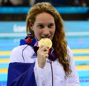 Camille Muffat (FRA) celebrates after receiving a gold medal for winning the women's 400m freestyle finals during the London 2012 Olympic Games at Aquatics Centre.