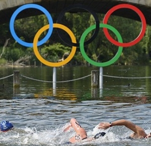 Swimmers make their way past the Olympic rings hanging over the water in the men's open water 10km swim during the London 2012 Olympic Games at Hyde Park. Mellouli won the gold medal