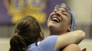 Stephanie Peacock of the North Carolina Tarheels celebrates after setting a new NCAA record in the 1650 freeestyle final during the NCAA Womens Division I Championship at the James A. Martin Aquatic Center.