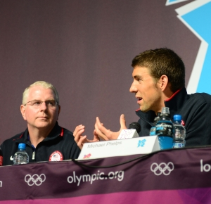 United States swimmer Michael Phelps (right) speaks as his coach Bob Bowman looks on during a press conference at the MPC.