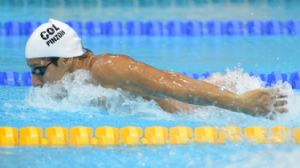 Omar Pinzon (COL) swims in a men's 200m butterfly heat during the 2012 London Olympic Games at Aquatics Centre.