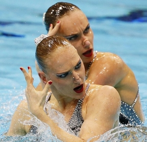 Natalia Ishchenko and Svetlana Romashina (RUS) perform their technical routine during qualifications during the London 2012 Olympic Games at Aquatics Centre.