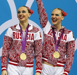 Natalia Ishchenko and Svetlana Romashina (RUS) stand on the podium after winning the gold in the duet final during the London 2012 Olympic Games at Aquatics Centre.