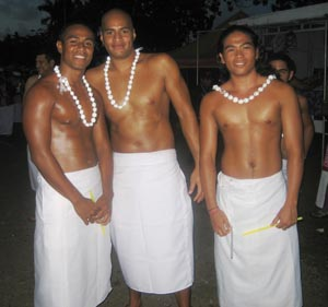 Opening Ceremony with swimmers Leatulevao, Scanlan and Wei leading the American Samoan team with flag and placard.