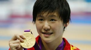 Ye Shiwen (CHN) poses with her gold medal after winning the women's 200m individual medley finals during the London 2012 Olympic Games at Aquatics Centre.