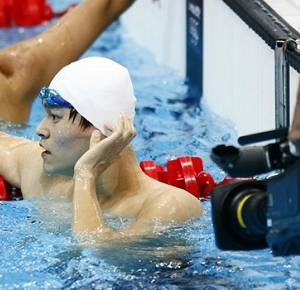 Sun Yang (CHN) and Li Yungi (CHN) react after competing during the men's 200m freestyle heats during the 2012 London Olympic Games at Aquatics Centre.