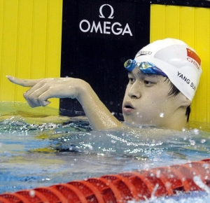 Shanghai, CHINA; Sun Yang of China celebrates setting a new world record in the Men's 1500m Freestyle Final during Day sixteen of the 14th FINA World Championships at the Oriental Sports Center.