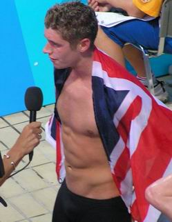 bronze medalist in 1500 free wearing british flag