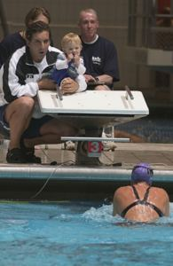 Olympian Roque Santos and daughter root for mom, Debbie Santos at USMS Nationals, IUPUI 2004