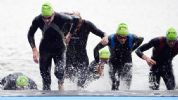Aug 7, 2012; London, United Kingdom; Athletes make their way out of the water after the swimming portion in the Serpentine lake during the men's triathlon during the London 2012 Olympic Games at Hyde Park. Mandatory Credit: Christopher Hanewinckel-USA TODAY Sports
