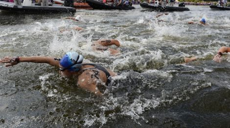 Aug 9, 2012; London, United Kingdom; Swimmers including Cecilia Biagioli (ARG, 24) complete the first lap in the women's open water 10km swimming during the London 2012 Olympic Games at Hyde Park. Mandatory Credit: Andrew P. Scott-USA TODAY Sports