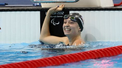 Sep 4, 2012; London, United Kingdom;  Courtney Jordan (USA) celebrates finishing second in the women's 50m freestyle S7 final during the London 2012 Paralympic Games at Aquatics Centre. Mandatory Credit: Paul Cunningham-US PRESSWIRE