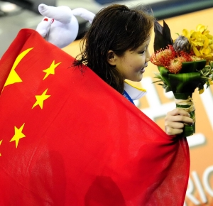 Shanghai, CHINA; Zhao Jing (CHN) celebrates after winning the gold medal in the women's 100m backstroke final at the 14th FINA World Championships.